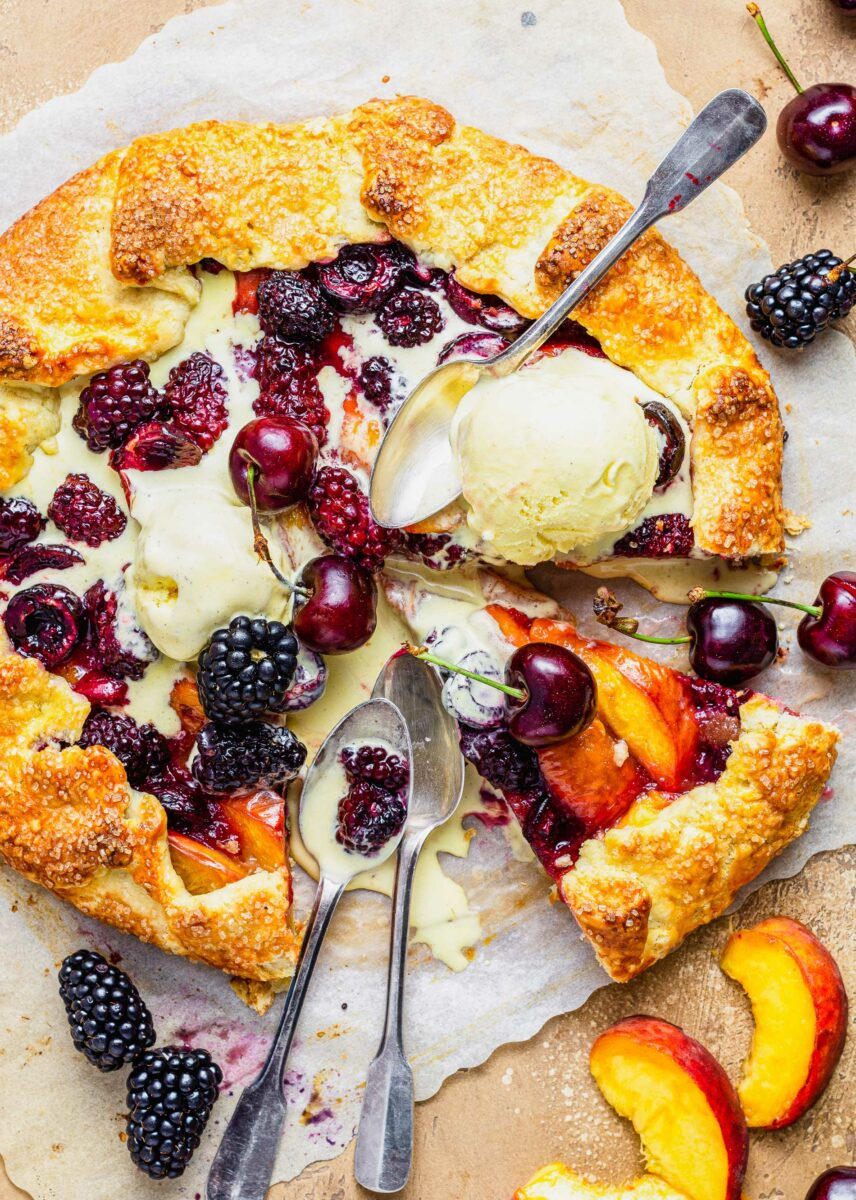 Melted vanilla ice cream is spread out over a galette.