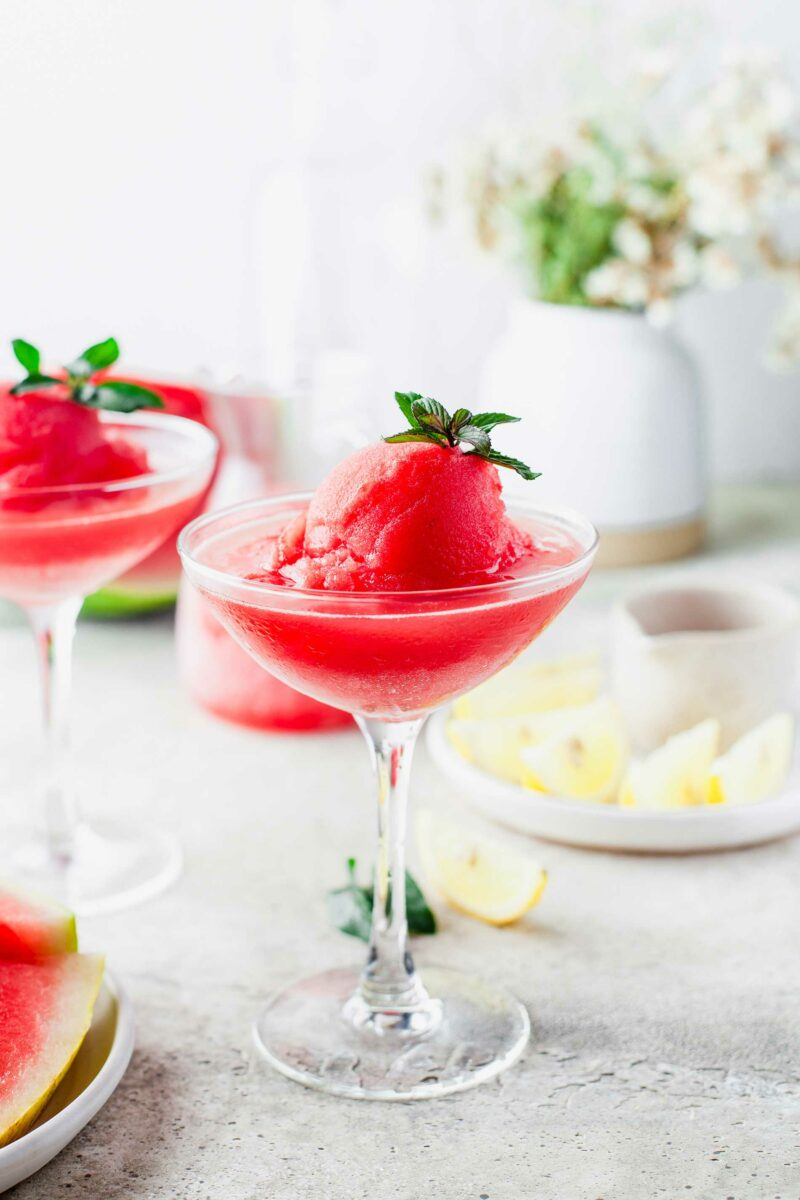 A martini glass is filled with watermelon frose.