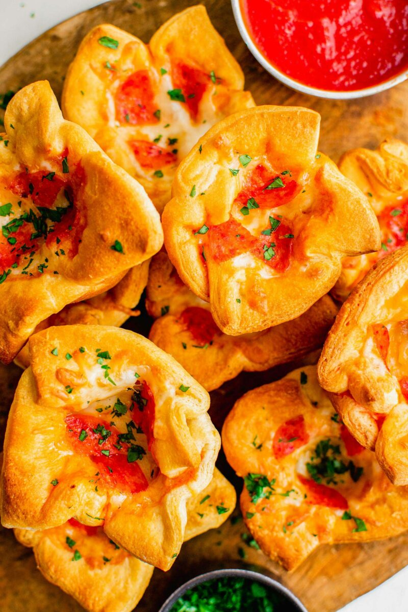 Pizza muffins in apple are garnished with freshly minced parsley.