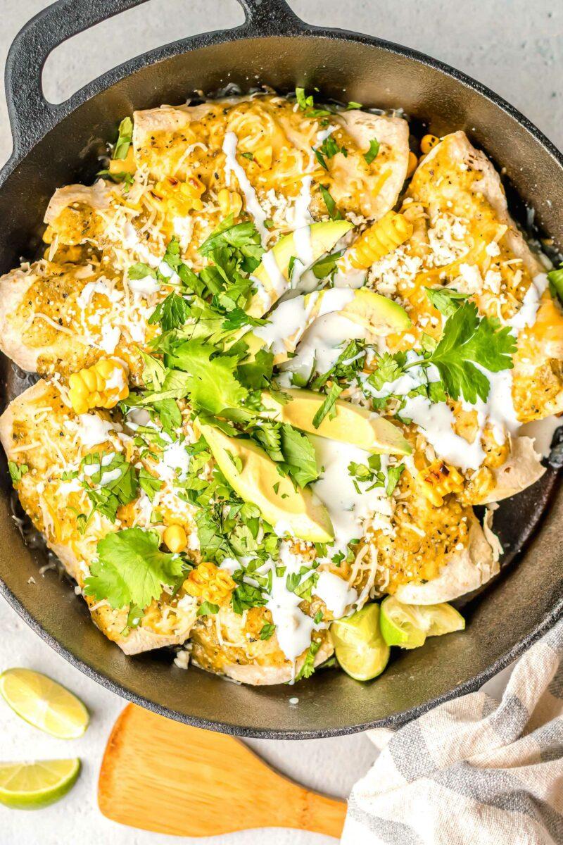 Enchiladas fill a large black dutch oven.