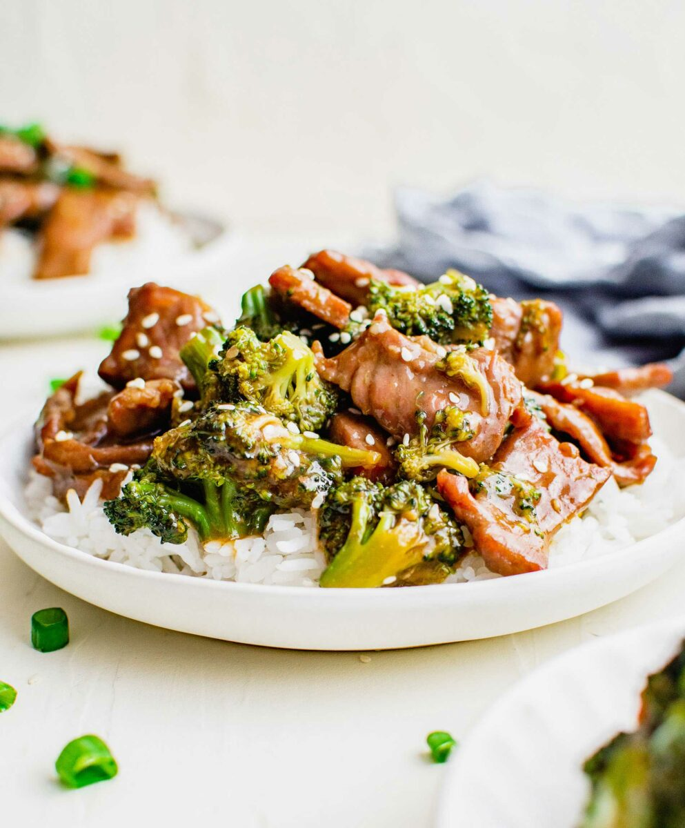 White rice, broccoli and beef are presented on a white plate.