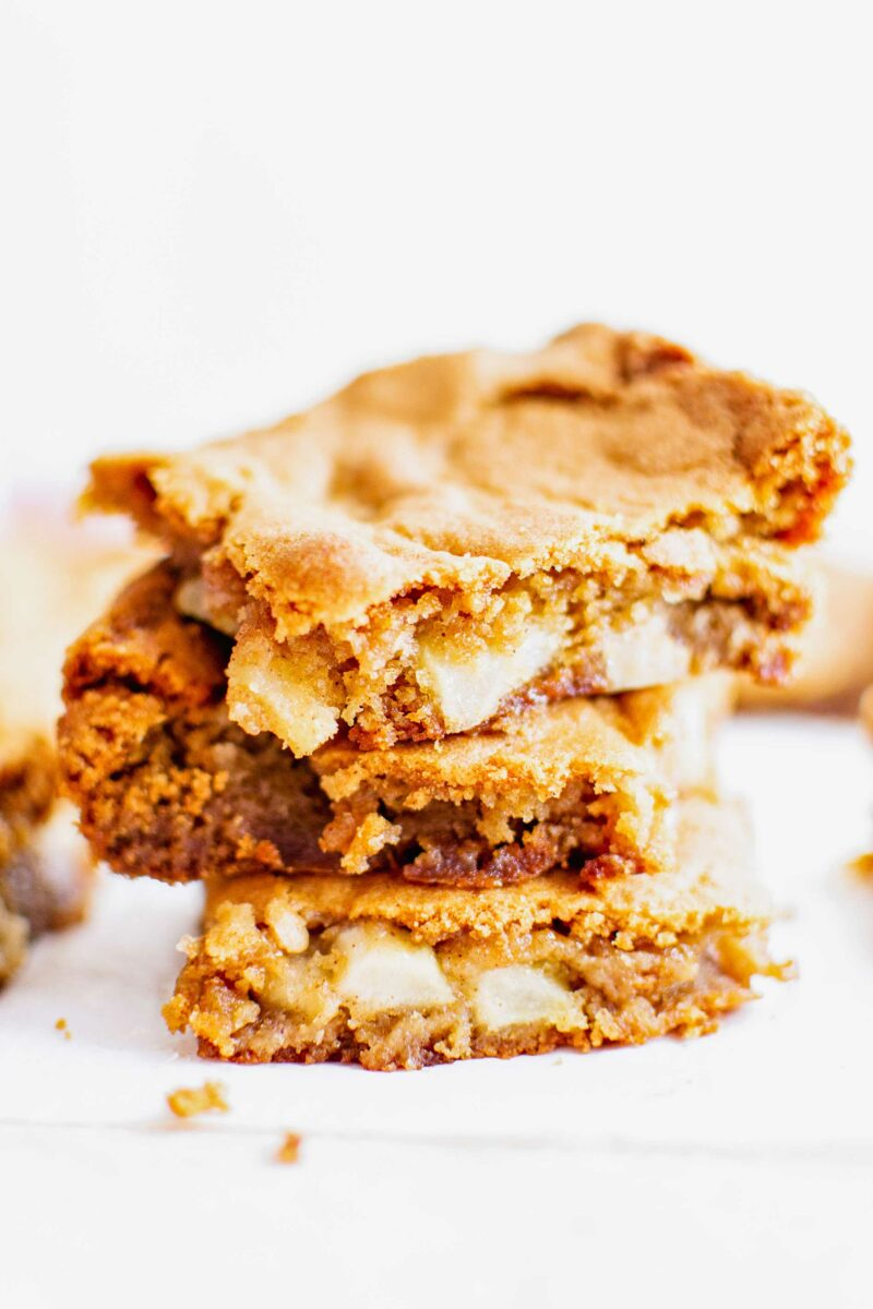 Three slices of blondies are stacked on top of one another.