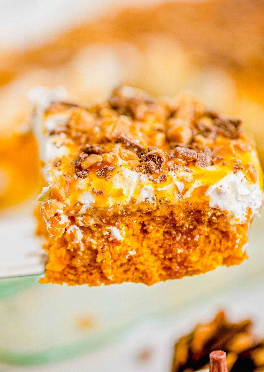 Pumpkin cake is topped with whipped cream caramel sauce and toffee bits.