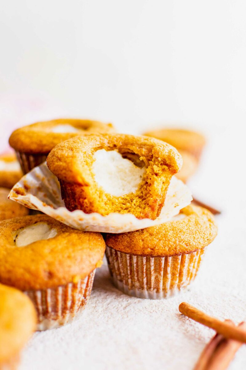 Several muffins are placed on top of one another.