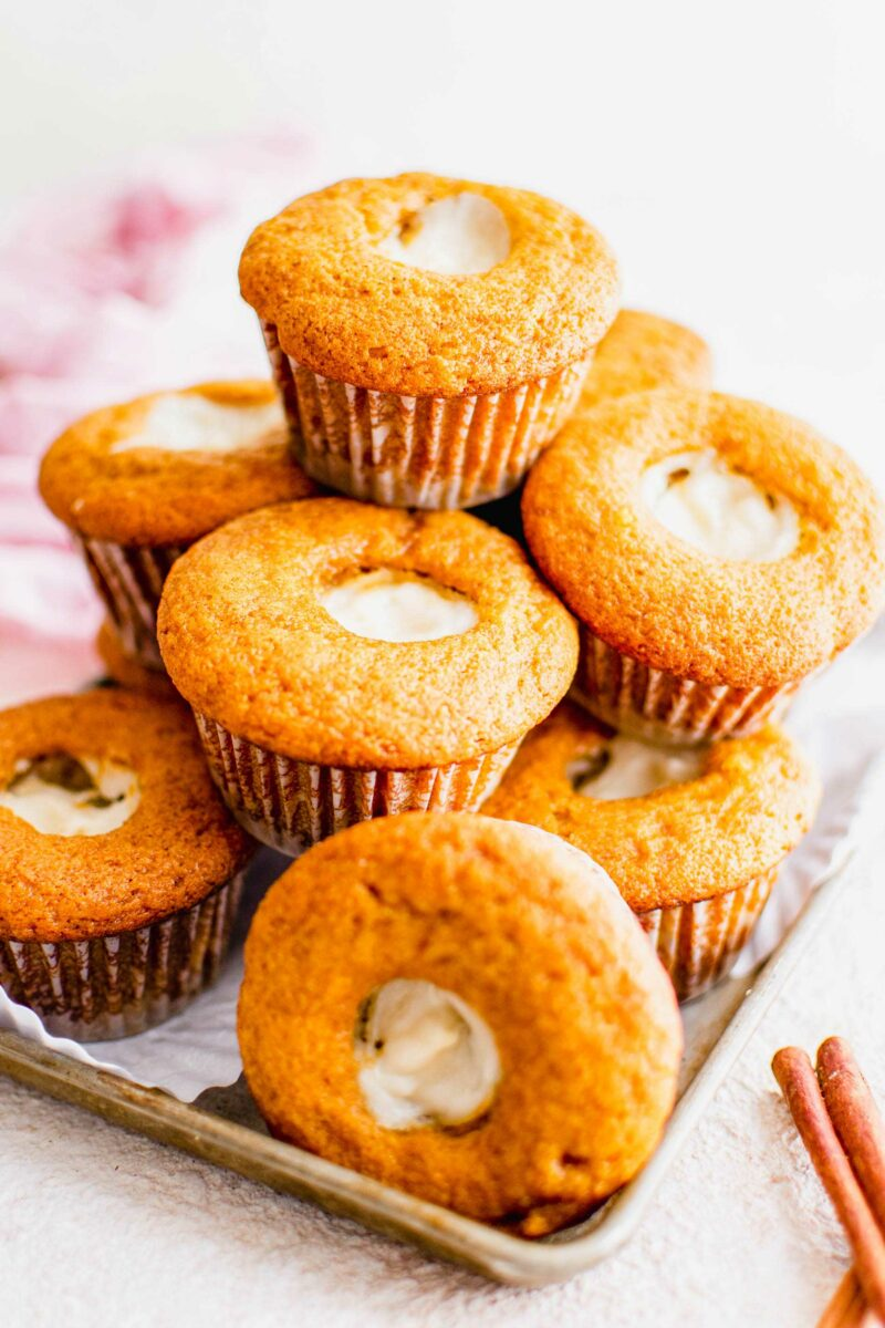 A stack of filled muffins is presented on a white surface.